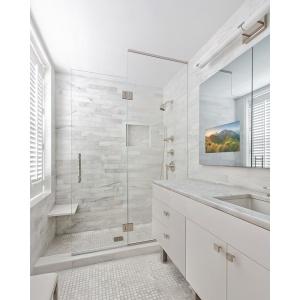 Modern bathroom vanity with a Seura Vanishing Vanity TV Mirror.