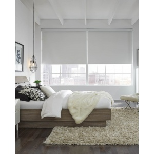 Lutron automated room-darkening shades in a loft bedroom.